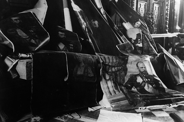 Portraits of the czar, his father and grandfather, are ripped from the walls in Petrograd during the victorious October Revolution.