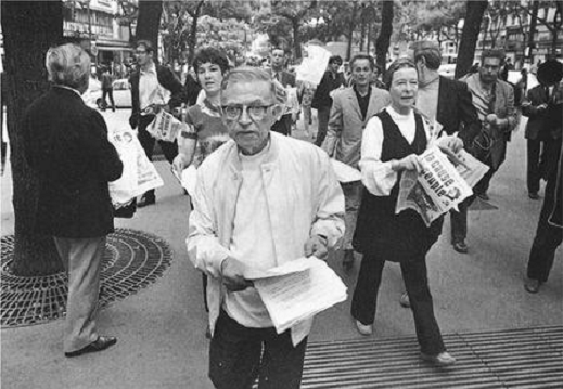 Jean-Paul Sartre and Simone de Beauvoir defying a government ban by illegally distributing La Cause du Peupl e in the spring of 1970. Photo: Gilles Peress. Source: Magnum Photo.