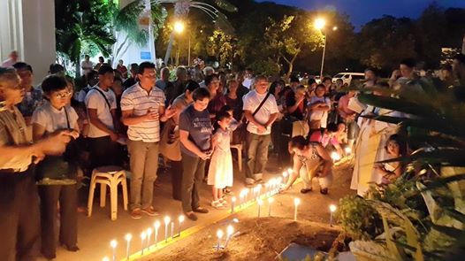Cebuanos light candles outside the Redemptorist Church to commemorate the 30th year anniversary of Fr. Rudy Romano's abduction by the armed men of the Marcos dictatorship in July 11, 1985.